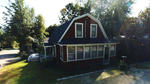 4BR Gambrel Style Home - .11+/- Acres Auction Photo